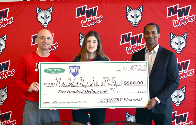 Niles West swimmer Mia Piljevic (center) is honored for being selected as Countrywide Financial's Athlete of the Month (December). She accepts a check alongside Coach Jason Macejak (left) and Countrywide Financial's Craig Cline (right).